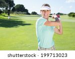 Lady Golfer Teeing Off And...