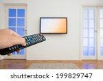watching tv in the living room | Shutterstock . vector #199829747