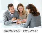 couple signing loan grant on... | Shutterstock . vector #199869557