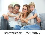 Small photo of Portrait of happy family of four wearing eyeglasses