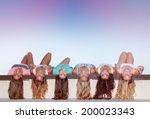 happy teens with long healthy...   Shutterstock . vector #200023343
