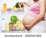 pregnant woman and refrigerator ... | Shutterstock . vector #200061383