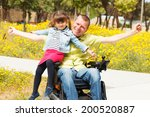 disabled father showing freedom ... | Shutterstock . vector #200520887