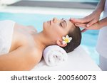 tranquil brunette getting a...   Shutterstock . vector #200560073