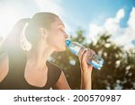 beautiful young woman drinking... | Shutterstock . vector #200570987