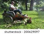 Landscaper Cutting Grass On...