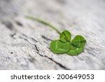 four leaf clover on wooden... | Shutterstock . vector #200649053
