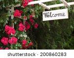 red flowers and welcome wood... | Shutterstock . vector #200860283