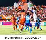 Small photo of SISAKET THAILAND-JUNE 21: Chanin Sae-Eae of Singhtarua FC. (white) in action during Thai Premier League between Sisaket FC and Singhtarua FC at Sri Nakhon Lamduan Stadium on June 21,2014,Thailand