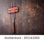 slices of beef steak on meat... | Shutterstock . vector #201161003