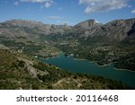 Dam and lake in the mountains of the popular touristic destination Costa Blanca in Spain - stock photo