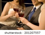 the couple toasting with a wine | Shutterstock . vector #201207557