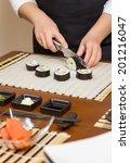 closeup of woman chef cutting... | Shutterstock . vector #201216047