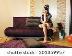 girl in the hose after housework | Shutterstock . vector #201359957