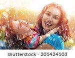 the family enjoys the rain | Shutterstock . vector #201424103