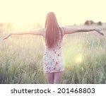 girl in a dress standing in a... | Shutterstock . vector #201468803