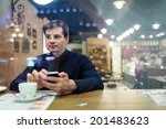 man at the table texting and... | Shutterstock . vector #201483623