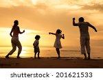 happy beautiful family dancing... | Shutterstock . vector #201621533