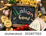 Small photo of Italian food on vintage wood background, with chalkboard, with text