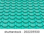 closeup of the green clay roof... | Shutterstock . vector #202235533