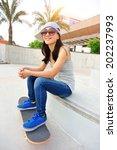 woman skateboarder at skatepark    Shutterstock . vector #202237993