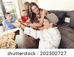 friends eating pizza  smiling ... | Shutterstock . vector #202302727