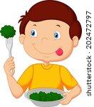 cute little boy eats vegetable... | Shutterstock .eps vector #202472797