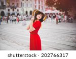 A Happy Girl In A Red Dress An...