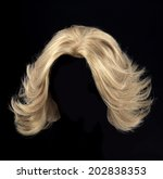 female blonde wig on a black... | Shutterstock . vector #202838353