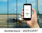 hand holding mobile smart phone ... | Shutterstock . vector #202913557