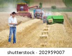 young landowner with laptop... | Shutterstock . vector #202959007