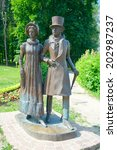 Small photo of Dmitrov, Russia - June 7 2014: Couple of young nobles on a walk. 'Townsfolk' sculptural composition on Kropotkin street (sculptor A. Karaulov, architect G. Gulyayeva, 2003).