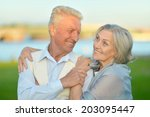 senior couple hugging on a... | Shutterstock . vector #203095447