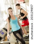 young couple training in the gym | Shutterstock . vector #203129857