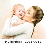 mother and baby kissing and... | Shutterstock . vector #203177353