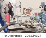 the worker prepares the device... | Shutterstock . vector #203224327