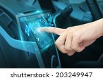 pushing on car screen interface ... | Shutterstock . vector #203249947