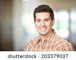 handsome smiling young man...   Shutterstock . vector #203379037