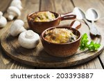 mushrooms baked with cheese... | Shutterstock . vector #203393887