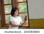 the cute middle aged asian... | Shutterstock . vector #203583883