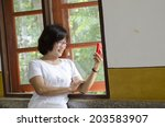 the cute middle aged asian... | Shutterstock . vector #203583907