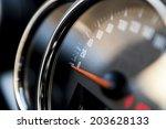 close up shot of a speedometer... | Shutterstock . vector #203628133
