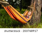 young woman lying in a hammock... | Shutterstock . vector #203768917