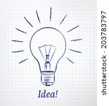 light bulb drawn on notebook... | Shutterstock .eps vector #203783797