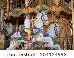 Cute Kid  Riding On A Carousel...