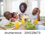 happy family enjoying a healthy ... | Shutterstock . vector #204228673