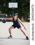 basketball player dribbling | Shutterstock . vector #204314473