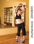 a female dancer practicing in... | Shutterstock . vector #2043855