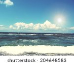 Sea Waves With Sun And Blue Sky