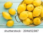 fresh lemons in retro colander. | Shutterstock . vector #204652387